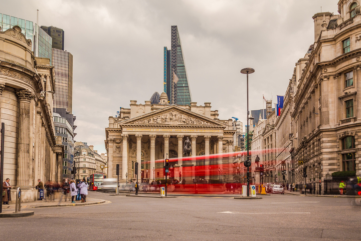 London, UK - March 25, 2015: The Bank of England during the day at Bank Junction showing buildings and the blur of people and traffic