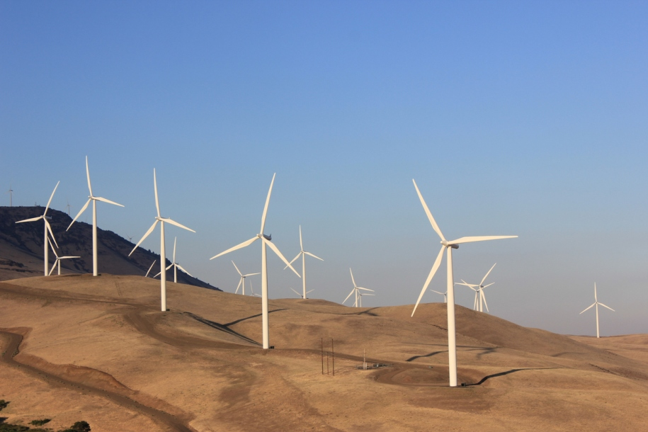 A Wind Farm on the top of a hill; close to the Columbia River; in the Washington State.