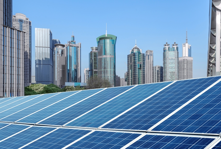 Skyscrapers in Shanghai, China, with solar panels in the foreground